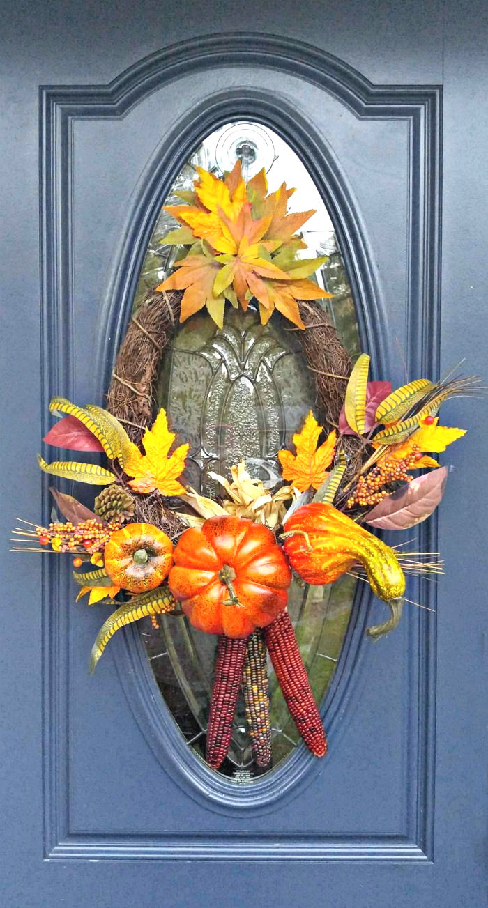 Thanksgiving wreath with Indian corn and autumn leaves