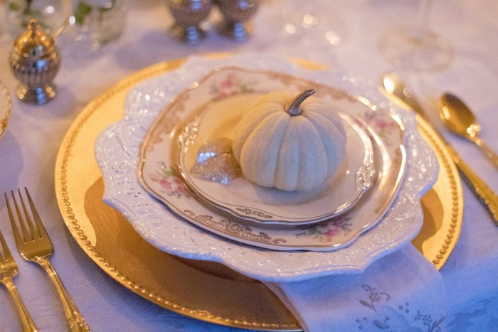 holiday table setting with small pumpkin