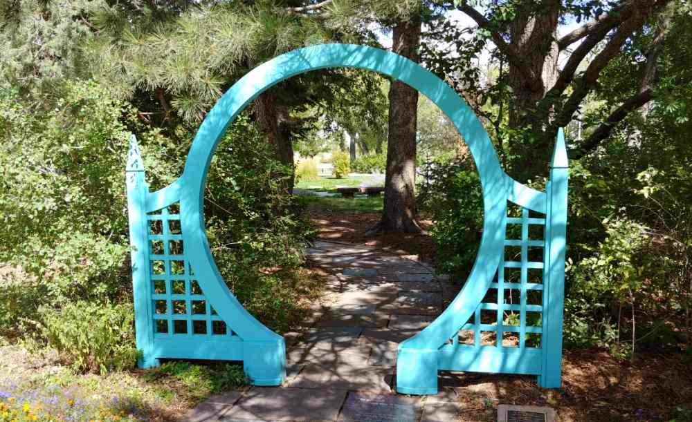 teal colored garden arch.
