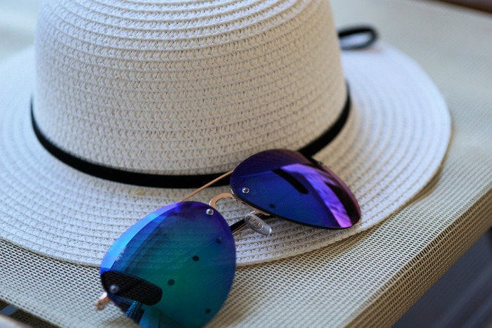 Sun hat and sun glasses