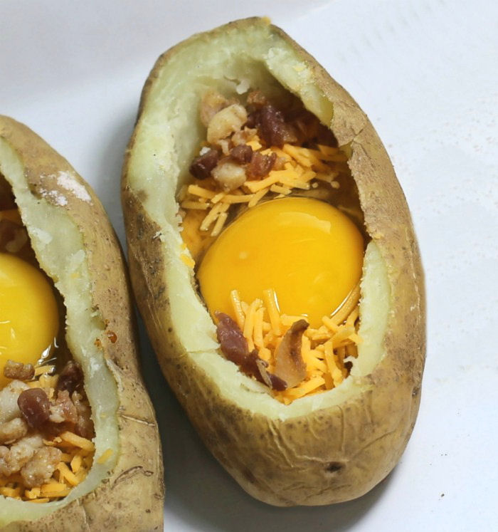 Eggs can be cooked in hollowed out potatoes in a campfire.