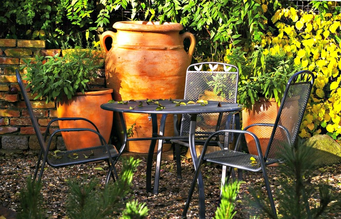 Terracotta pots and metal tables