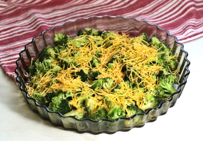 broccoli and cheese in a quiche pan