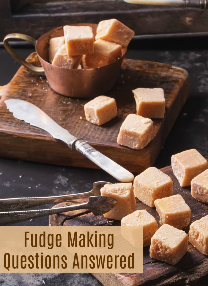 "Rustic scene with fudge, knife and tongs and words reading ""fudge making questions answered."""