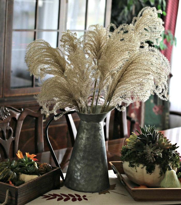 Silver grass in a galvanized water jug
