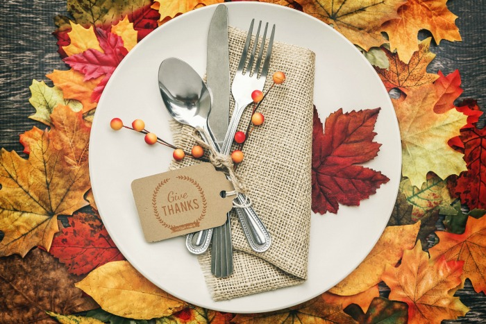 "Thanksgiving tablescape plate with a card reading ""Give thanks."""