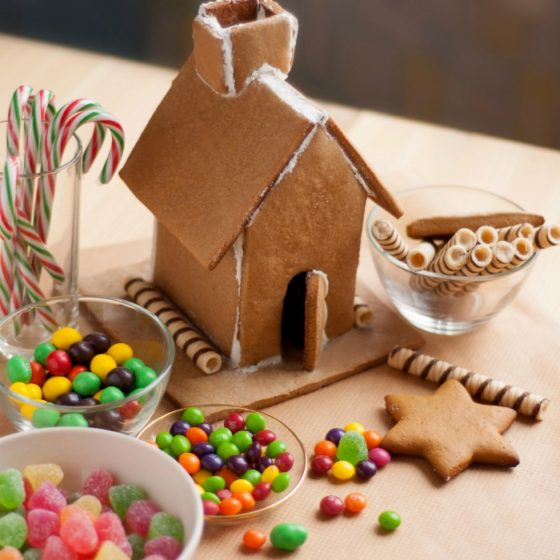 Candy and gingerbread house on a counter