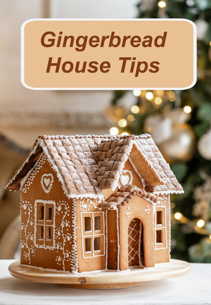 "Plain gingerbread house with white icing near a Christmas tree with words reading ""Gingerbread house tips."""