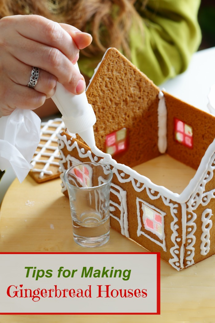 "Woman adding icing to a house with text reading ""tips for making gingerbread houses."""