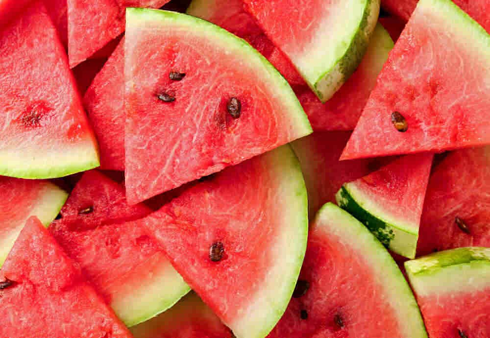 Slices of seeded watermelon.