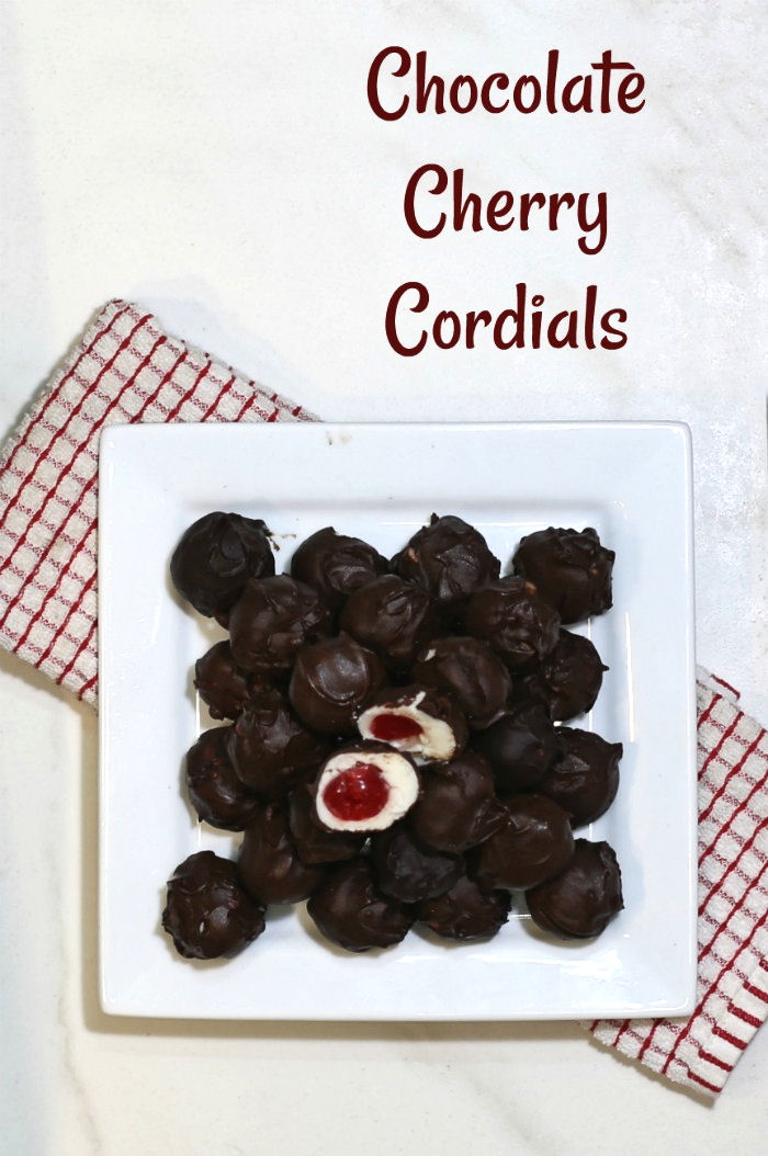 Chocolate cherry cordials on a white plate