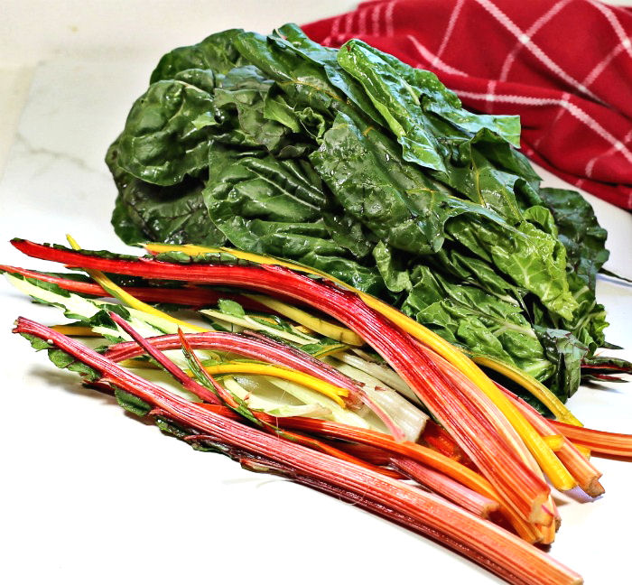 Cutting away Swiss chard leaves from the stems