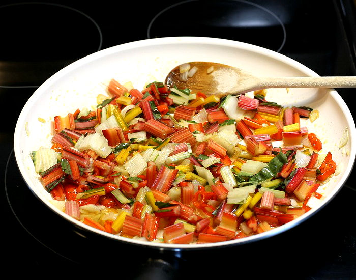 Cooking Swiss chard stems with onions and peppers in oil