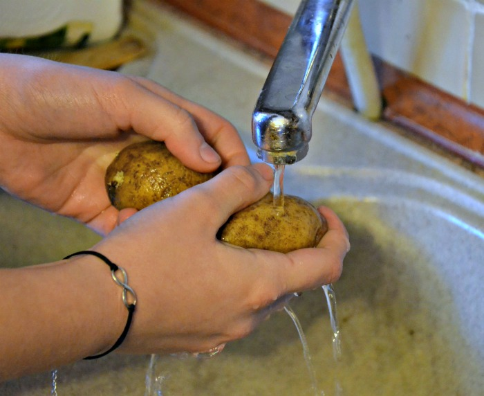 Washing potatoes before vegetable carving