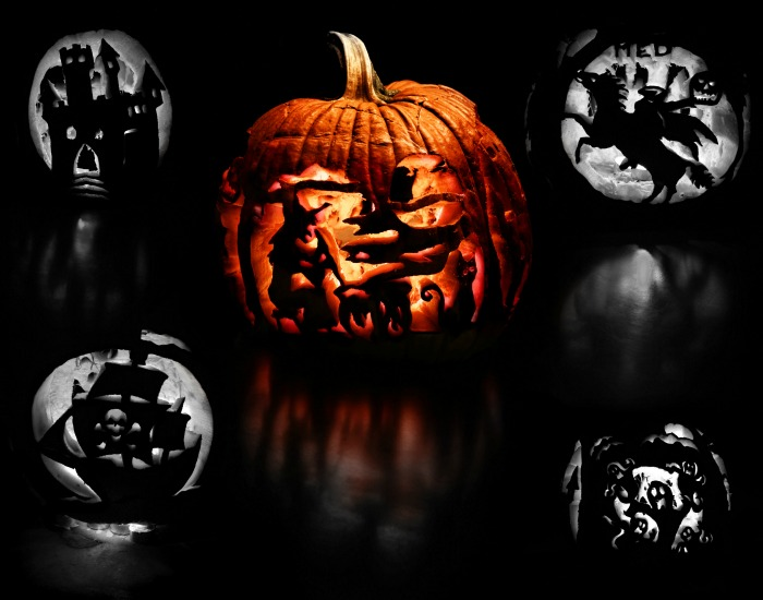 Fancy carved pumpkins on a black background.