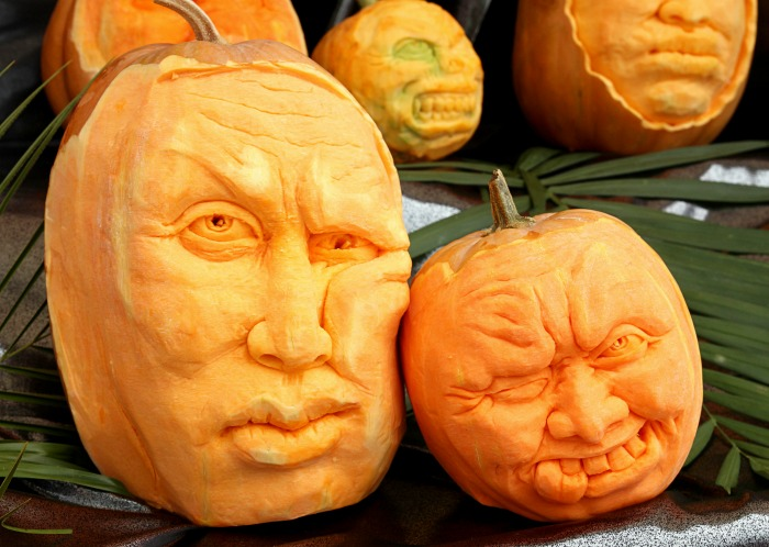 Human heads carved into pumpkins