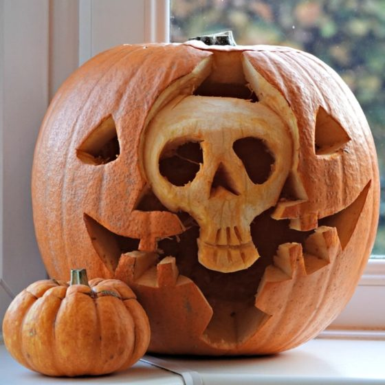 Skeleton head inside another carved pumpkin