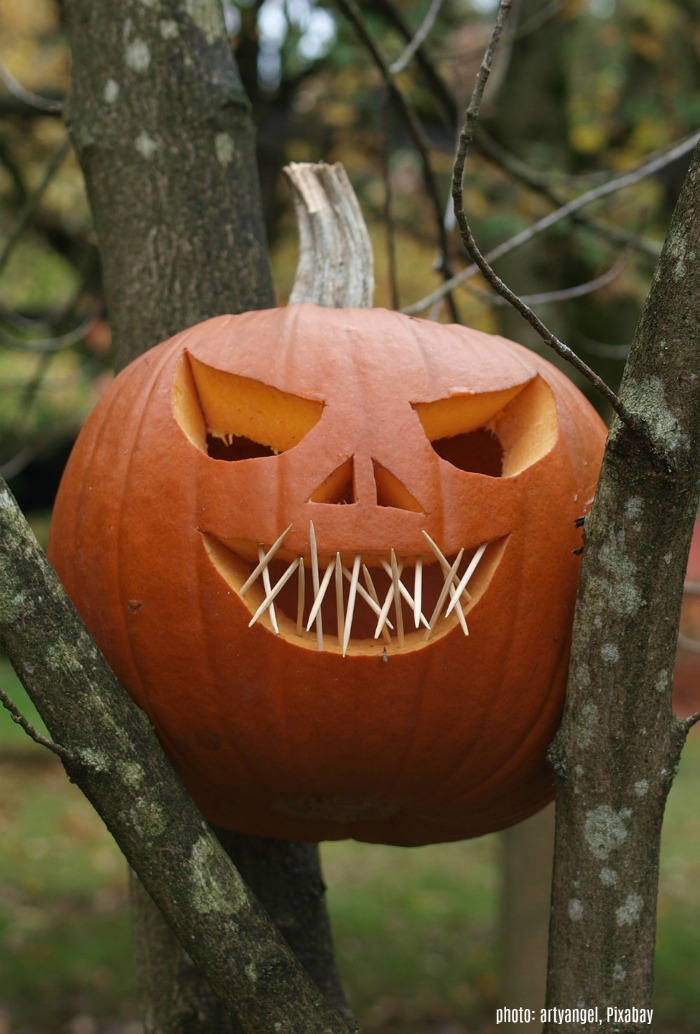 Carved pumpkin with toothpick teeth.
