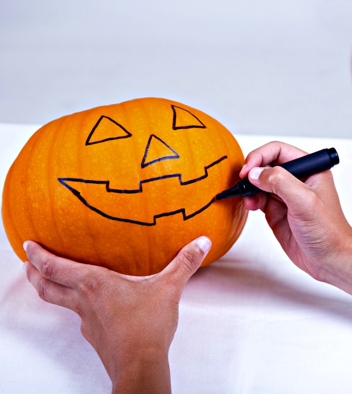 Tracing a pumpkin carving design