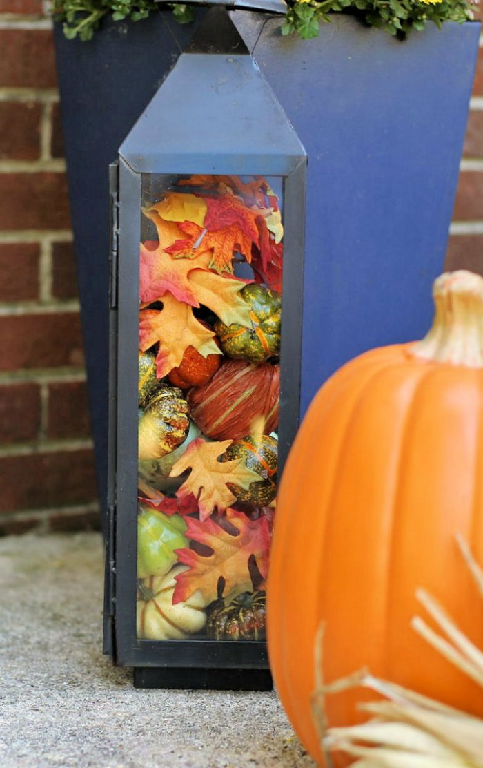 Decorating with natural elements is easy. Use a Black lantern filled with leaves, pumpkins and gourds