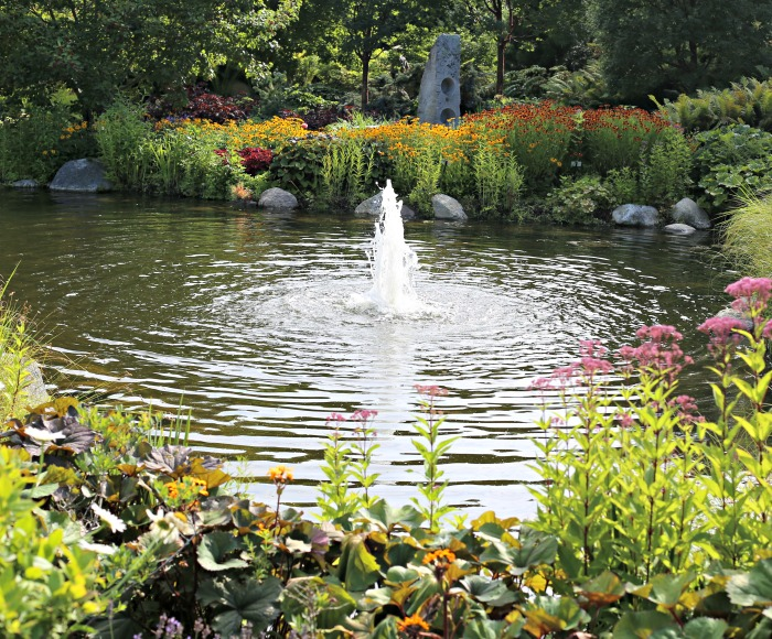 Fountain in a pond in the Garden of Five Senses at Boothbay Botanical Gardens in Maine