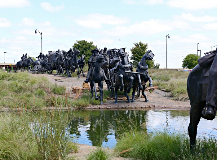 Bronze statues at the water edge of the riverwalk