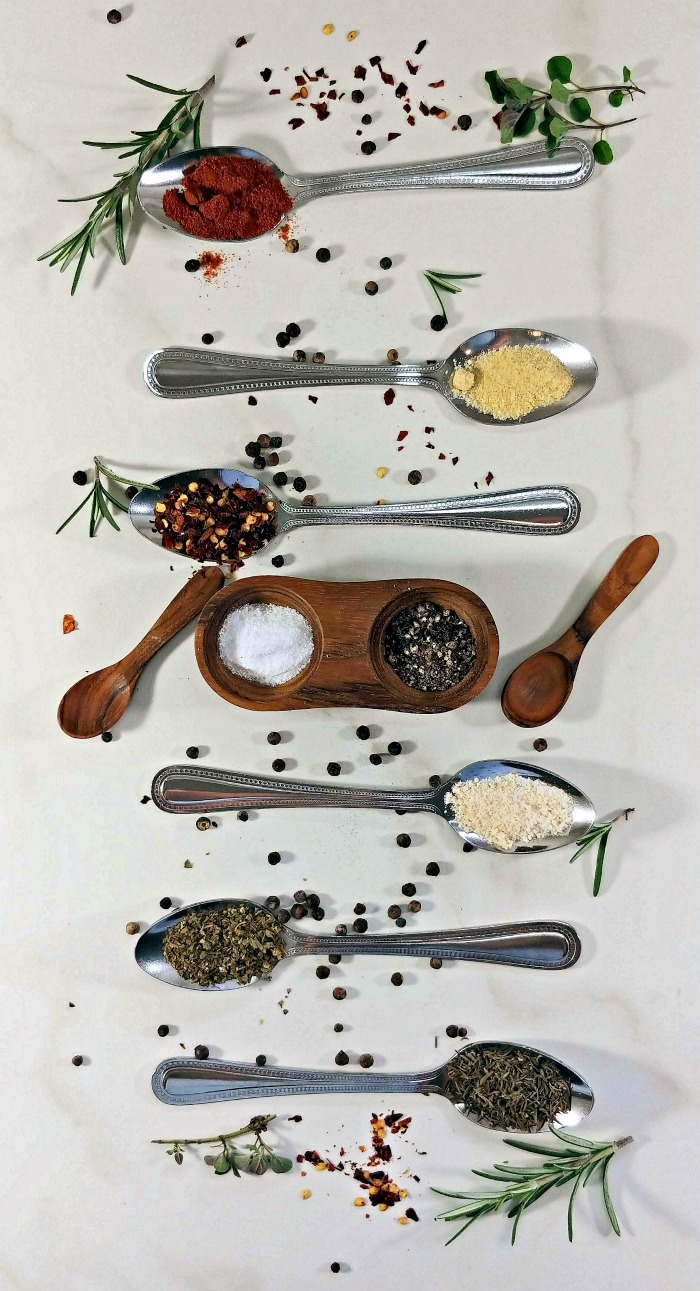 Spoons and spices for a spicy rub
