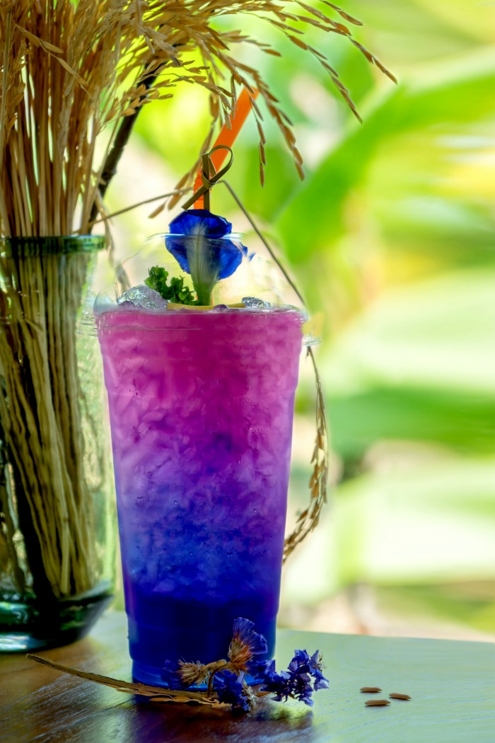 Butterfly tea flower drink changes color with shafts of wheat.