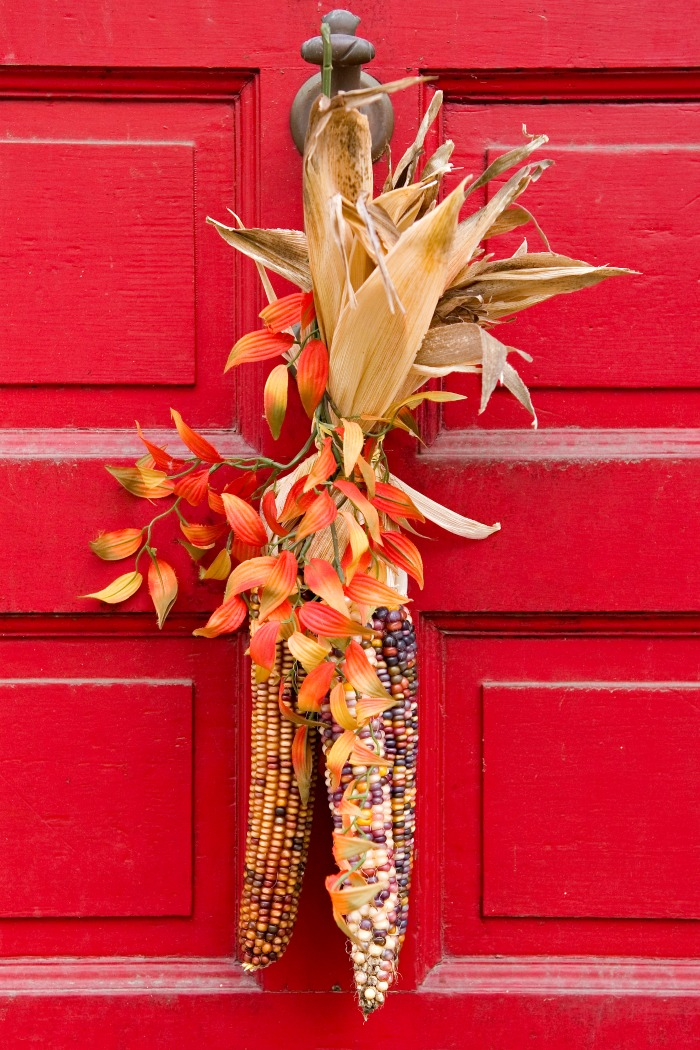 Indian corn door swag on a red door.