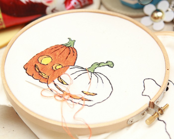 Embroidery hoop with Halloween cross-stitch patterns.