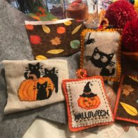 Yarn, pillows and Halloween cross stitch projects.