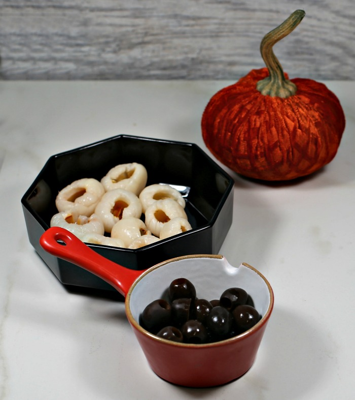 lychees, black olives and an orange pumpkin.