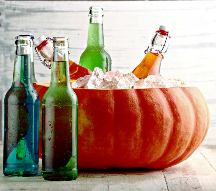 Halloween cocktail special effects - Using a pumpkin filled with ice as an ice bucket.