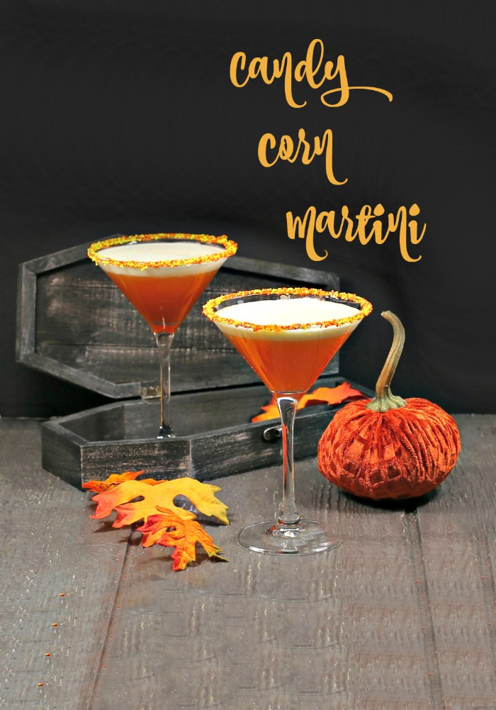 "Two layered drinks with a coffin and candle and text reading ""candy corn martini."""