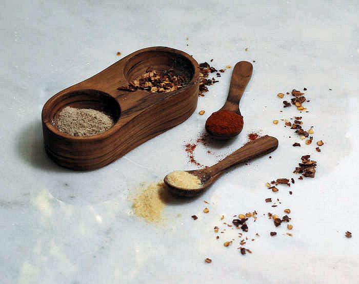 Wooden dispenser and spoons with Paprika, celery salt, red pepper flakes, onion powder