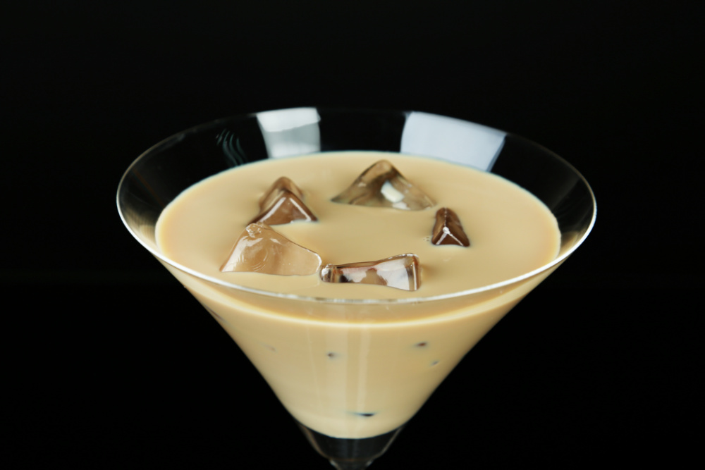 Glass of Bailey's Irish cream in a martini glass with ice.