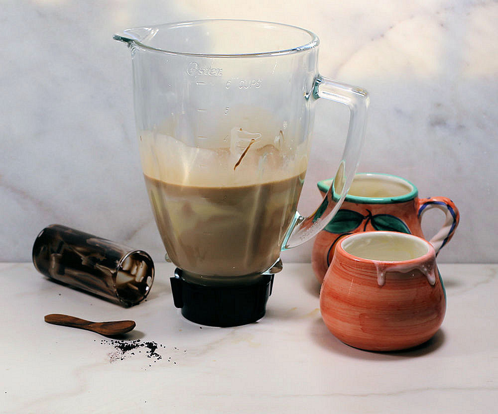 Making the recipe for Baileys Irish cream in a blender.