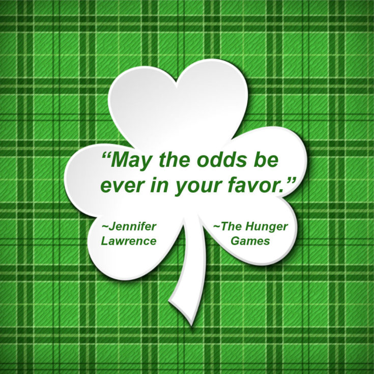 "Plaid background with shamrock and words ""May the odds be ever in your favor"" - Jennifer Lawrence The Hunger Games."""