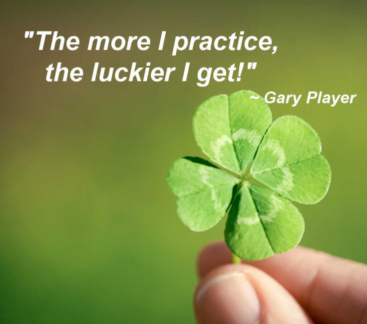 "Hand holding a four leaf clover with text reading ""The more I practice, the luckier I get."""
