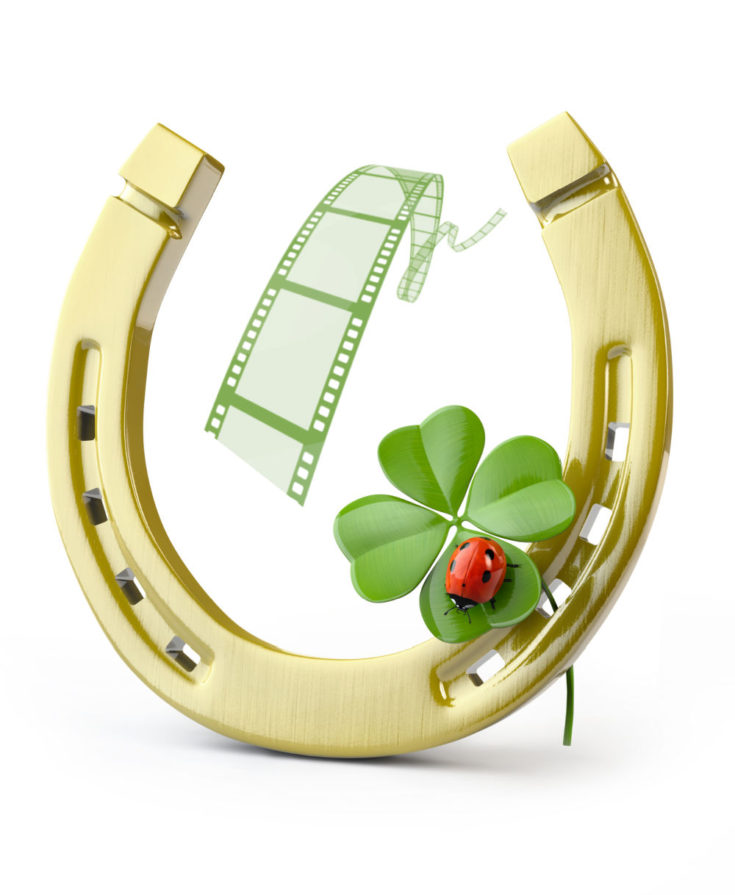 Shamrock and ladybug with horseshoe and move reel.