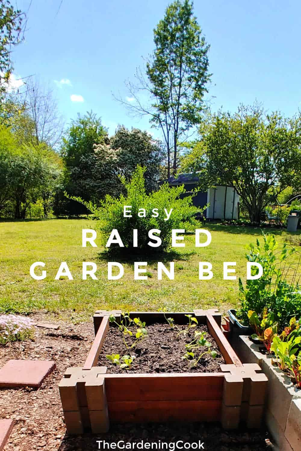Raised garden bed near a lawn with text overlay reading easy raised garden bed.