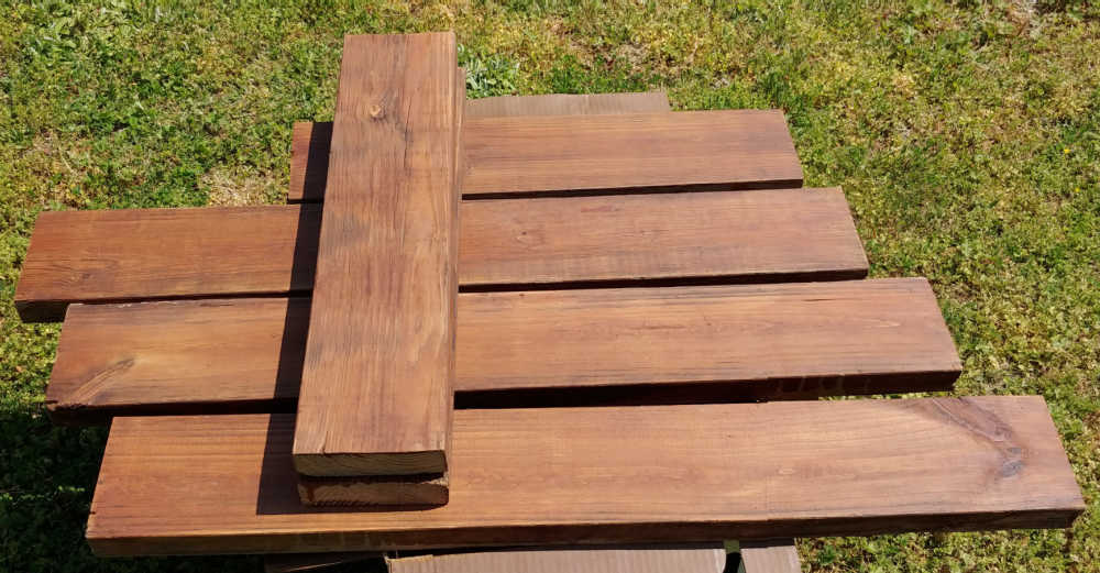 Lengths of boards stained with rustic oak wood stain.
