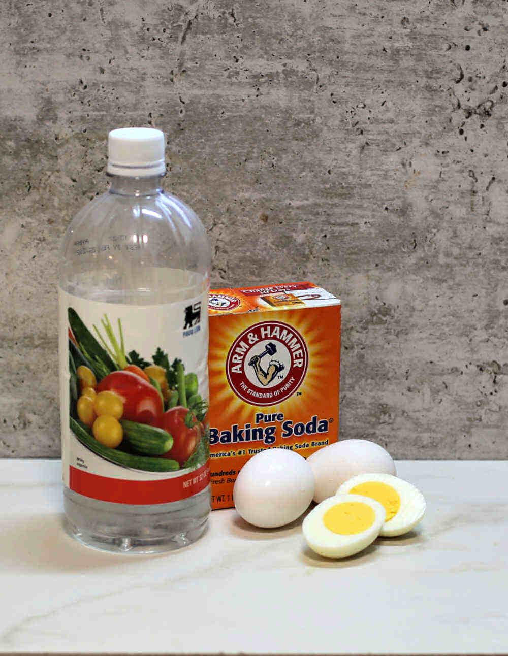 Vinegar, baking soda, eggs, hard boiled egg slices.