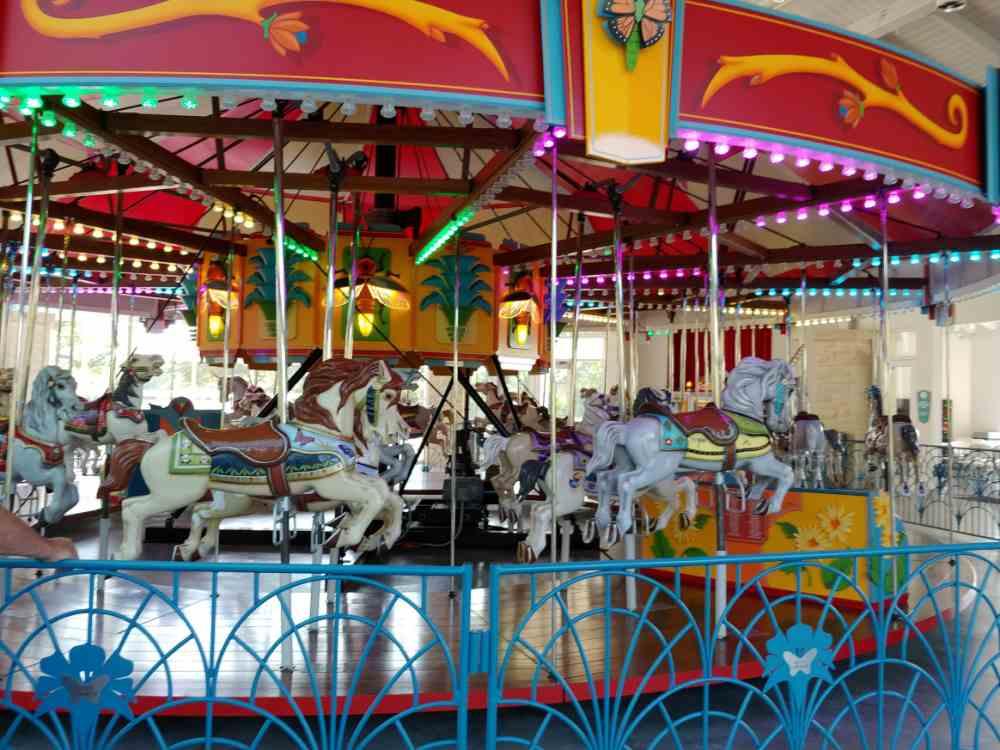 Joyland carousel with colorful horses.