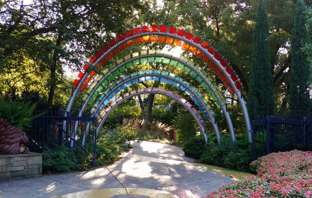 Rainbow archway made of colorful glass panes.