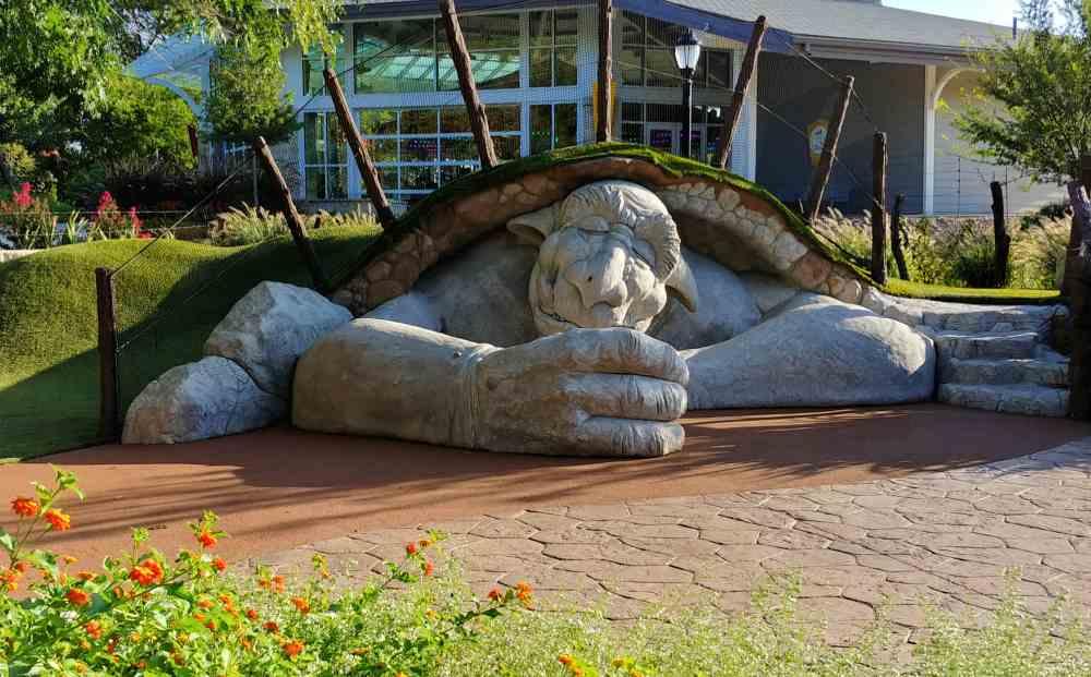 Sleeping troll under a grassy knoll.